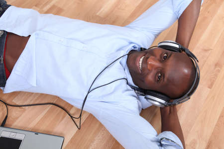 Relaxed man listening to music at home photo