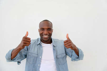 Portrait of smiling man showing thums up Stock Photo - 9638843