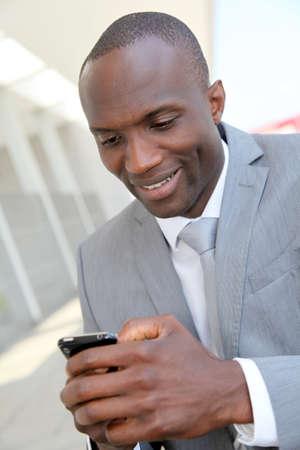 Portrait of businessman using mobile phone photo