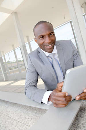Salesman on business travel using electronic tablet photo