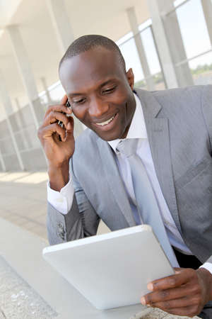 Salesman on business travel using electronic tablet Stock Photo - 9638819