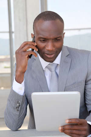 Salesman on business travel using electronic tablet Stock Photo - 9638875