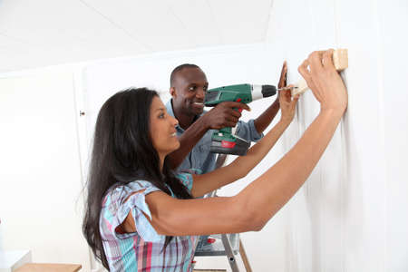 Young couple renovating their new house photo