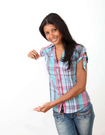 Cheerful girl holding whiteboard photo