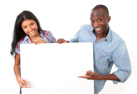 textspace: Cheerful couple showing message on whiteboard