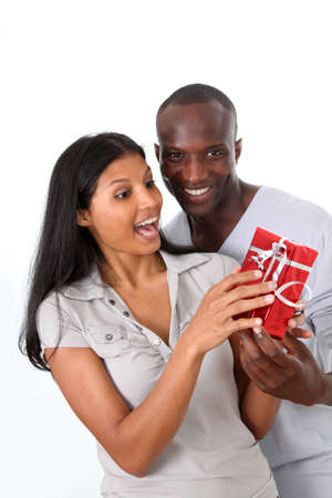 Man offering gift to woman on her birthday Stock Photo - 9784626
