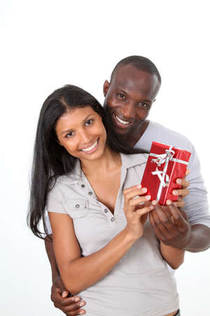 Man offering gift to woman on her birthday photo
