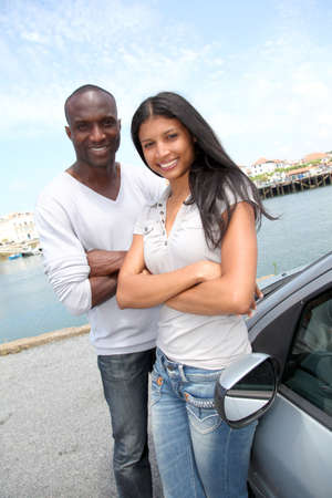 Cheerful couple in travel journey photo