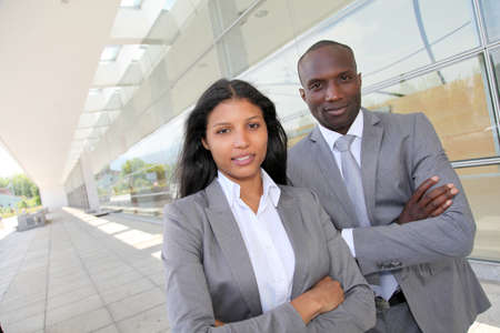 Business team standing outside congress center photo