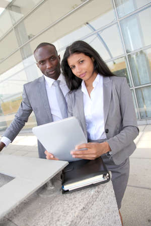 Business team working on electronic tablet photo