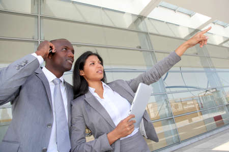 tradeshow: Business team standing outside congress center Stock Photo