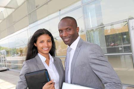 hispanic ethnicity: Business team standing outside congress center Stock Photo