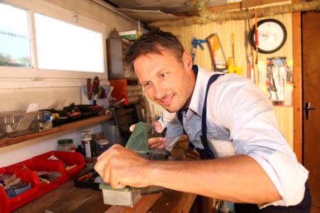 craftman: Joiner working wood in workshop Stock Photo