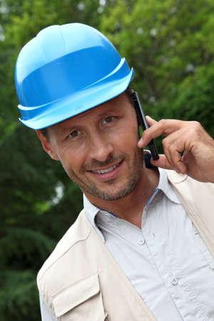 Entrepreneur talking on mobile phone photo