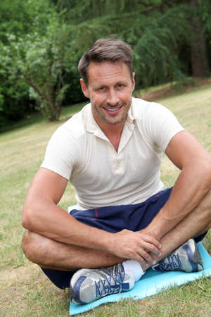 40 years old man: Handsome man doing fitness exercises outside Stock Photo