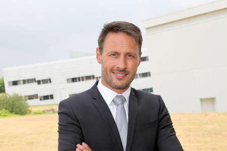 Portrait of smiling businessman in dark suit photo