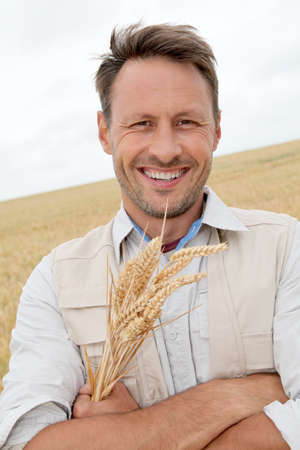 Portrait of handsome man standing in wheat field Stock Photo - 9784631