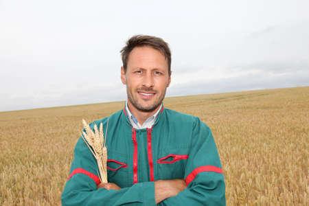 Portrait of happy farmer in wheat field photo