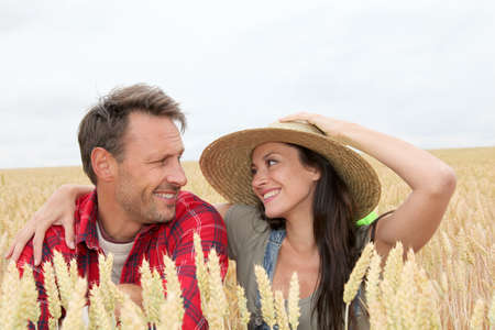 Portrait of happy couple in wheat field photo