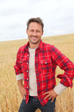 agronomist: Portrait of smiling man in countryside