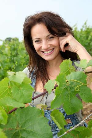 Portrait of smiling winegrower in vineyard photo