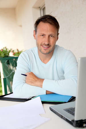 old business man: Man working at home on laptop computer