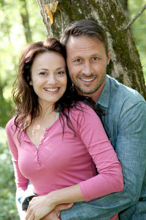 Portrait of smiling couple in forest Stock Photo - 9910807