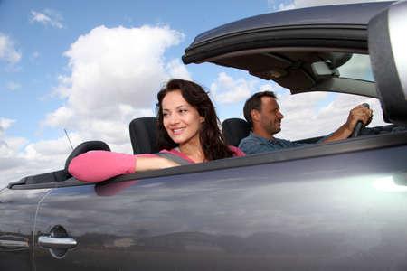 Couple riding convertible car Stock Photo - 9912161