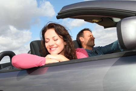 convertible car: Couple riding convertible car
