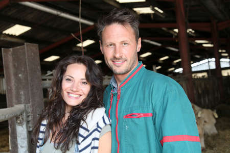 Couple of breeders standing in barn photo