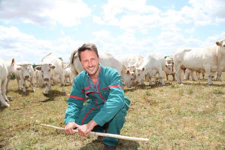 animal breeding: Portrait of breeder standing in farmland Stock Photo