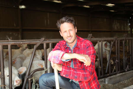 Portrait of smiling farmer in barn photo