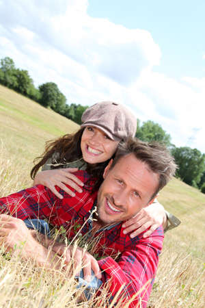 Happy couple laying down meadow Stock Photo - 9901661