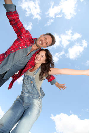 Couple jumping in the air photo