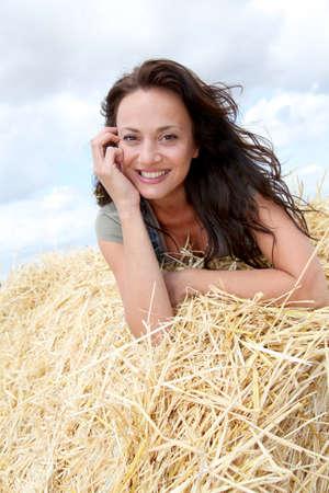Beautiful woman laying down bale photo
