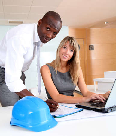 Architects working on laptop computer Stock Photo - 9901429