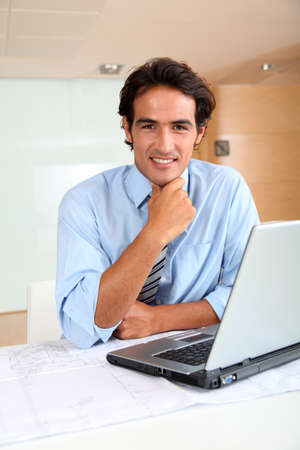 Businessman in office sitting at his desk Stock Photo - 9901503