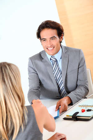 Car seller with buyer in office Stock Photo - 9908720