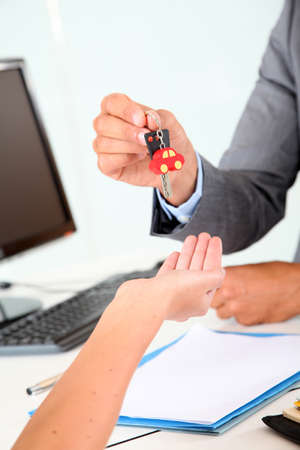 Closeup on car seller giving car key to buyer Stock Photo - 9785359