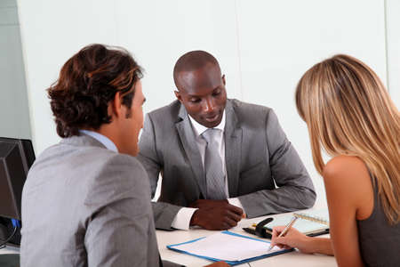 loans: Couple meeting businessman in office