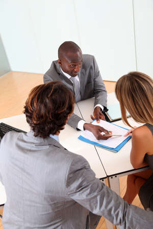 Couple meeting businessman in office Stock Photo - 9908874
