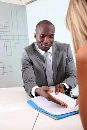 banker: Businessman having client signing contract