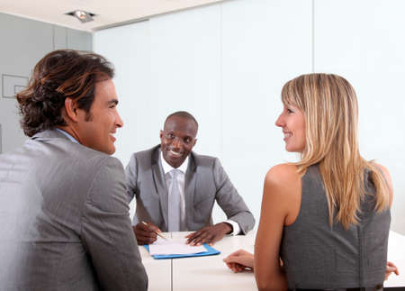 banker: Couple meeting businessman in office