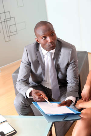 businessman signing documents: Businessman having client signing contract