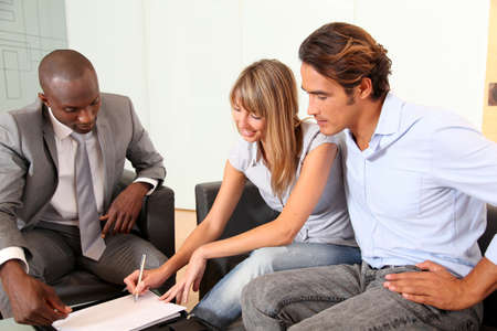 Couple signing home-purchase contract Stock Photo - 9910965