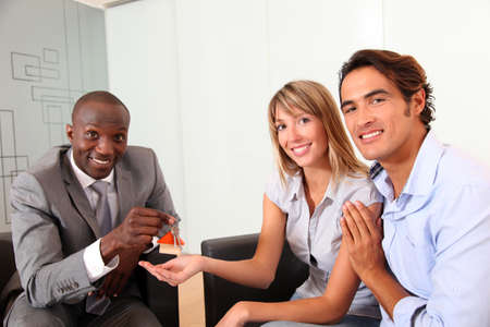 Real-estate agent giving keys to new property owners Stock Photo - 9901832