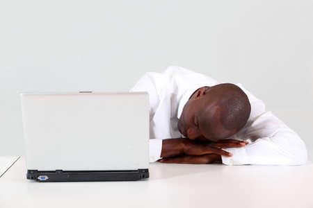 Businessman sleeping on his desk photo