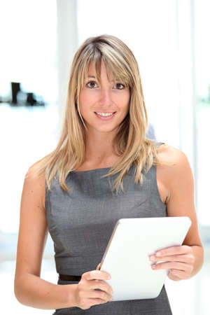 Businesswoman using electronic tablet