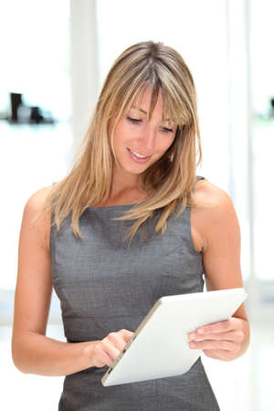 check in: Businesswoman using electronic tablet