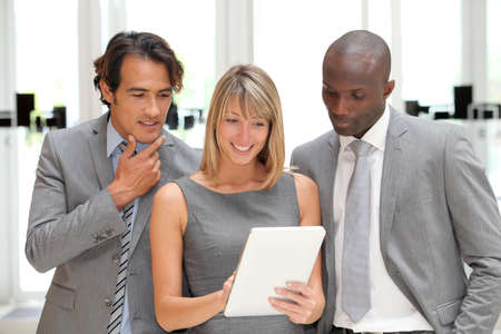 Business team meeting in congress center with electronic tablet Stock Photo - 9901828